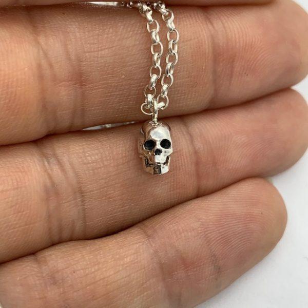 tiny skull pendant